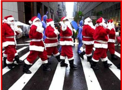 Hey,is that middle Santa giving us the finger?  Oh, excuse  me, that's a bell he's ringing.  This photo appeared on the Front Page of the NY Daily News on Saturday ,Nov. 29, 2003.  Photo credit goes to Daily News fotog David Handschuh.  Great shot, what one always expects from the Daily News!