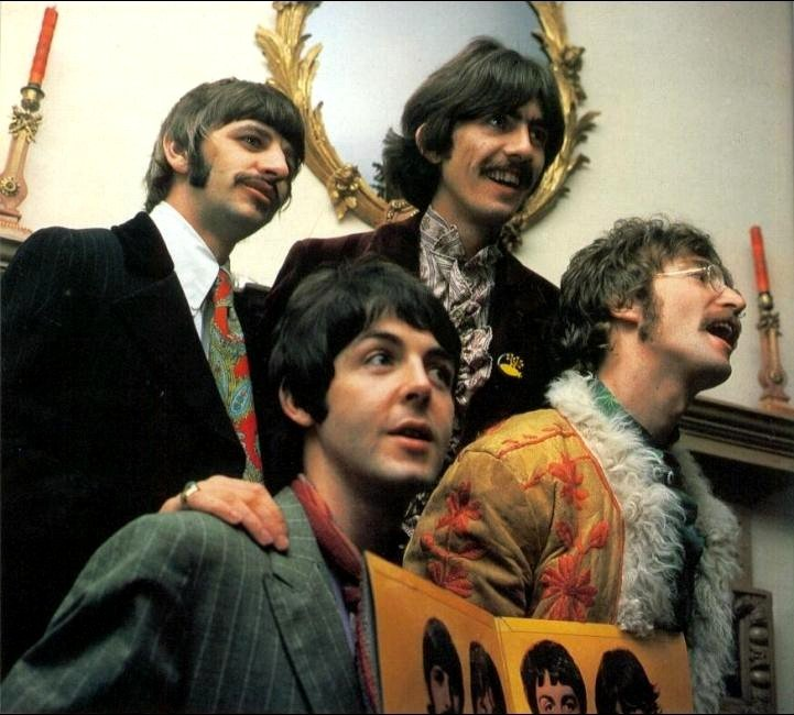 The Beatles, April 1967. At a pre-release party for Sgt. Pepper.<br />